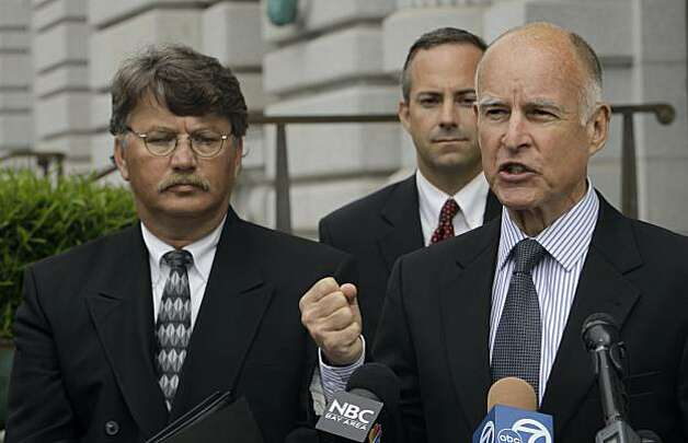California Attorney General Jerry Brown, right, running for governor of California, explains his defense of a state law enforcement policy that allows police to collect DNA samples from people who have been arrested but not convicted of any crime Tuesday,July 13, 2010, outside the United States Court of Appeals courthouse in San Francisco. Also pictured are Mark Sconce, member of Surviving Parents Coalition, left, and Michael Chamberlain of the Attorney General's office. Photo: Jeff Chiu, AP