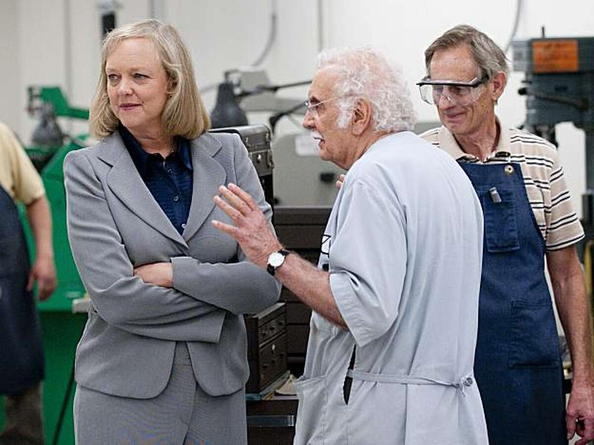 Anthony Maglica, center, leads Republican candidate for California Gov. Meg Whtman, left, on a tour of the Maglite manufacturing facility in Ontario, Calif., Thursday, July 15, 2010.