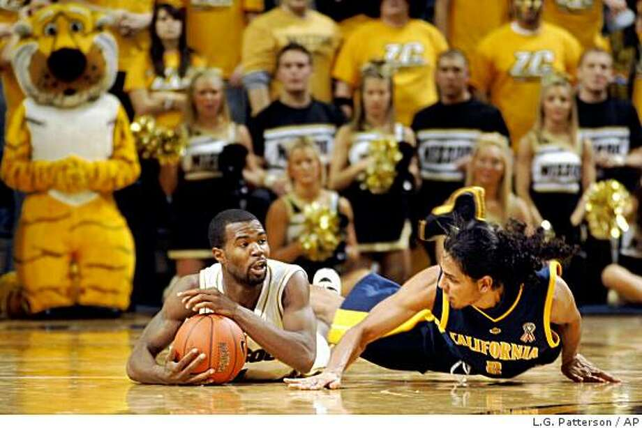 Missouri's Zaire Taylor, left, looks for help as he holds the ball away from California's Jorge Gutierrez during the second half of an NCAA college basketball game Sunday, Dec. 7, 2008, in Columbia, Mo. Missouri won the game 93-66. (AP Photo/L.G. Patterson) Photo: L.G. Patterson, AP