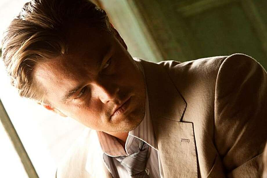 "Leonardo DiCaprio in ""Inception."" He plays a theif who steals secrets from the subconscious during the dream state and must now plant an idea in someone. Photo: Stephen Vaughan, Warner Bros."