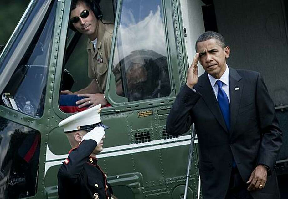 US President Barack Obama walks from Marine One to the White House on the South Lawn on July 9, 2010 in Washington. Obama was returning from an overnight trip to Missouri and Nevada where he attended fundraisers for Senate Majority Leader Harry Reid (D-NV) and US Senate candidate Robin Carnahan. Photo: Brendan Smialowski, AFP/Getty Images
