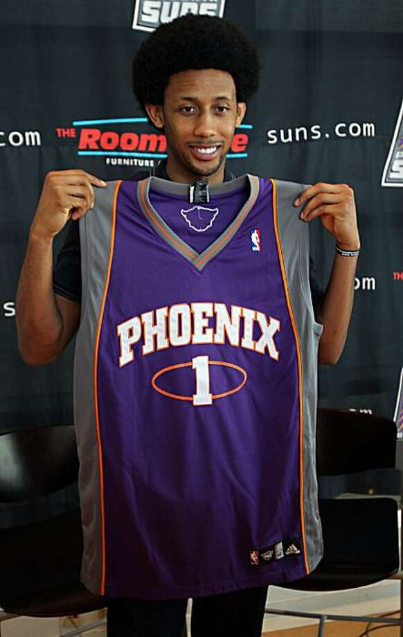 Newly aquired Phoenix Suns' swingman Josh Childress shows his new jersey Wednesday, July 14, 2010 in Phoenix. Childress returns to the NBA after spending the past two seasons playing in Greece. Photo: Matt York, AP