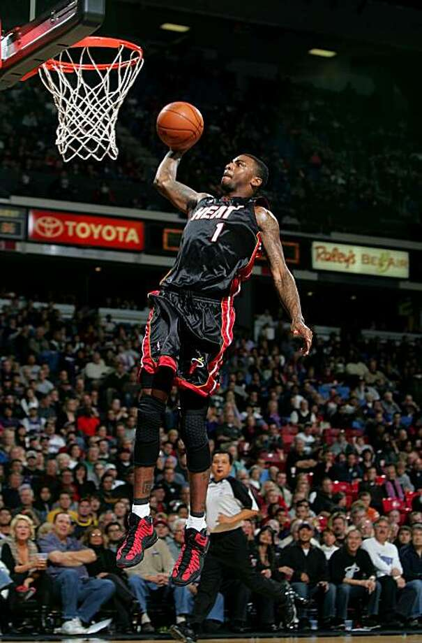 SACRAMENTO, CA - DECEMBER 06:  Dorell Wright #1 of the Miami Heat goes up to dunk the ball during their game against the Sacramento Kings at ARCO Arena on December 6, 2009 in Sacramento, California.  NOTE TO USER: User expressly acknowledges and agrees that, by downloading and/or using this Photograph, user is consenting to the terms and conditions of the Getty Images License Agreement.  (Photo by Ezra Shaw/Getty Images) Photo: Ezra Shaw, Getty Images
