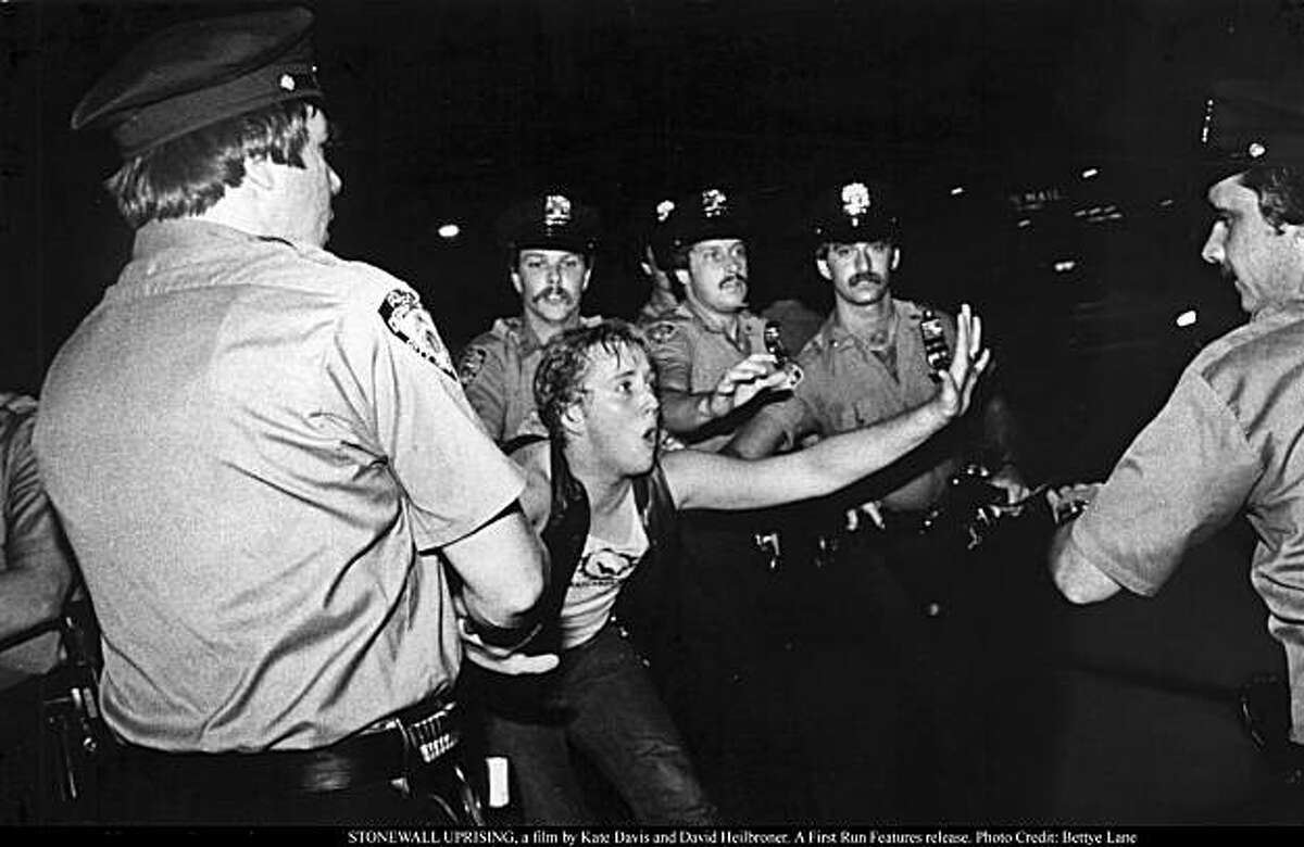 A patron of the Stonewall Inn confronts New York police, as seen in STONEWALL UPRISING, a film by Kate Davis and David Heilbroner.