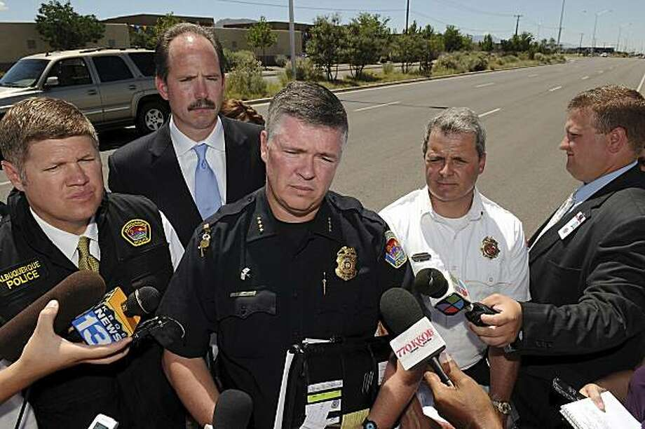 From left, Albuquerque Public Safety Director Darren White, Albuquerque Mayor Richard J. Berry, Albuquerque Police Department Chief Ray Schultz, Albuquerque Fire Department Chief James Breen give a news conference about the multiple fatal shooting at the Emcore facility in Albuquerque, N.M. Monday July 12, 2010, about a mile from the shooting scene. A gunman opened fire at the Albuquerque fiber optics manufacturer on Monday, killing five people and wounding four others before turning the gun on himself in what police said was a domestic violence dispute. (AP Photo/The Albuquerque Journal, Pat Vasquez-Cunningham) EXAMINER.COM/ALBUQUERQUE OUT Photo: Pat Vasquez-Cunningham, AP
