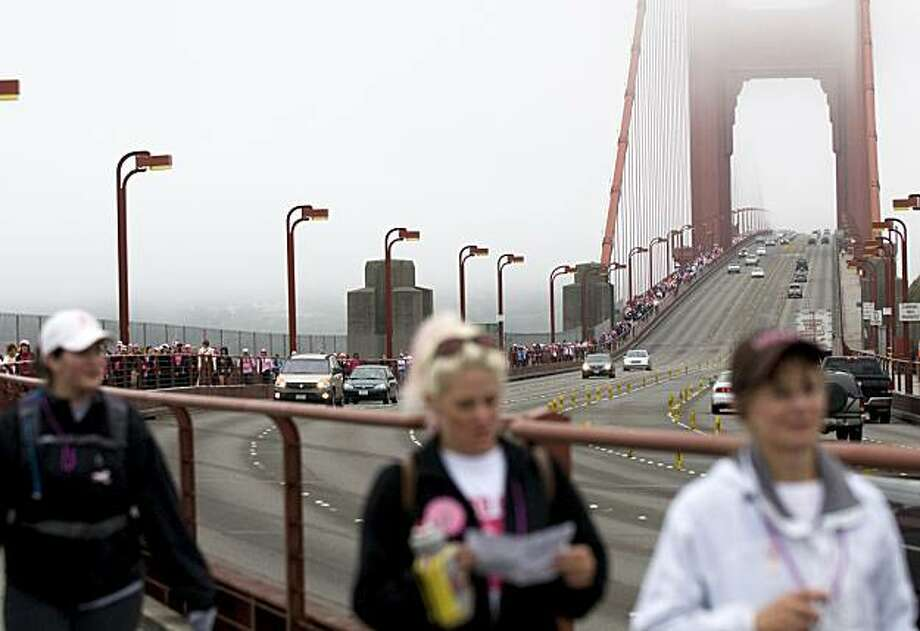 The thousands of walkers make their way across the Golden Gate Bridge during the sixth annual Avon Walk for Breast Cancer in San Francisco on Saturday. Photo: Chad Ziemendorf, The Chronicle