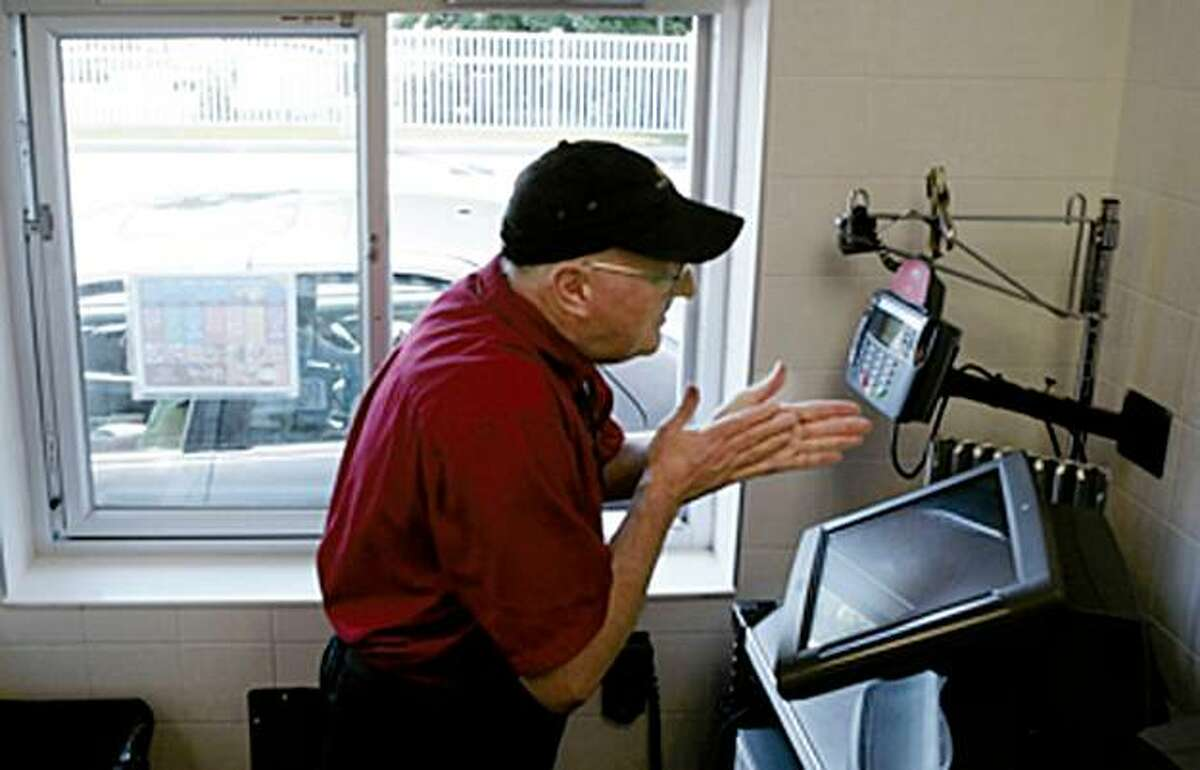 MCDONALDS WORKER: Ray Aronson rubs his hands with excitement before meeting the next customer at McDonald's in Vernon, Conn. Aronson, 59, has been working at the same McDonald's for the past 40 years. Illustrates MCDONALDS-WORKER (category a) by Elizabeth Sile (c) 2009, The Hartford Courant. Moved Thursday, July 23, 2009. (MUST CREDIT: The Hartford Courant photo by Michael McAndrews.) Ray Aronson rubs his hands with excitement before meeting the next customer at McDonald's in Vernon, Conn. Aronson, 59, has been working at the same McDonald's for the past 40 years. Illustrates MCDONALDS-WORKER (category a) by Elizabeth Sile (c) 2009, The Hartford Courant. Moved Thursday, July 23, 2009. (MUST CREDIT: The Hartford Courant photo by Michael McAndrews.)