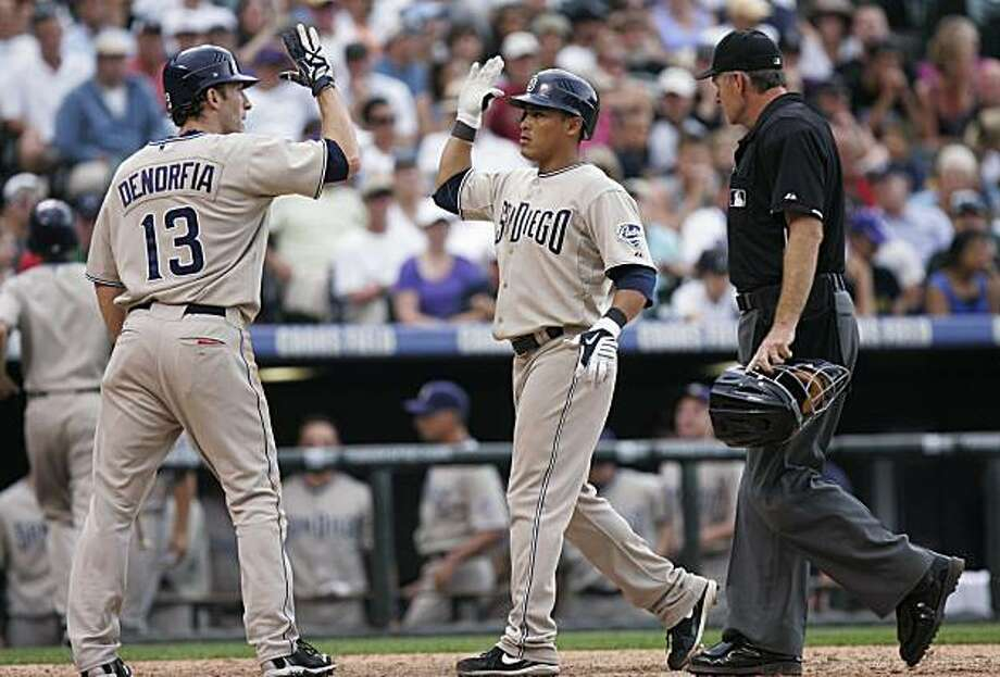 San Diego Padres' Chris Denorfia (13) greets Everth Cabrera, right, after his ninth-inning home run during a baseball game in Denver on Sunday, July 11, 2010. The Padres won 9-7. Photo: Barry Gutierrez, AP