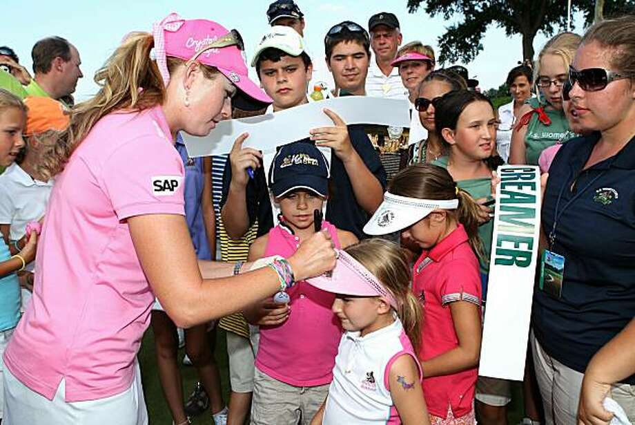 OAKMONT, PA - JULY 11:  Paula Creamer signs autographs for fans after her four-stroke victory at the 2010 U.S. Women's Open at Oakmont Country Club  on July 11, 2010 in Oakmont, Pennsylvania. Photo: Scott Halleran, Getty Images