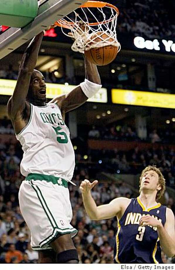 BOSTON - DECEMBER 03:  Kevin Garnett #5 of the Boston Celtics dunks the ball as Troy Murphy #3 of the Indiana Pacers defends on December 3, 2008 at TD Banknorth Garden in Boston, Massachusetts.  NOTE TO USER: User expressly acknowledges and agrees that, by downloading and or using this Photograph, user is consenting to the terms and conditions of the Getty Images License Agreement.  (Photo by Elsa/Getty Images) Photo: Elsa, Getty Images