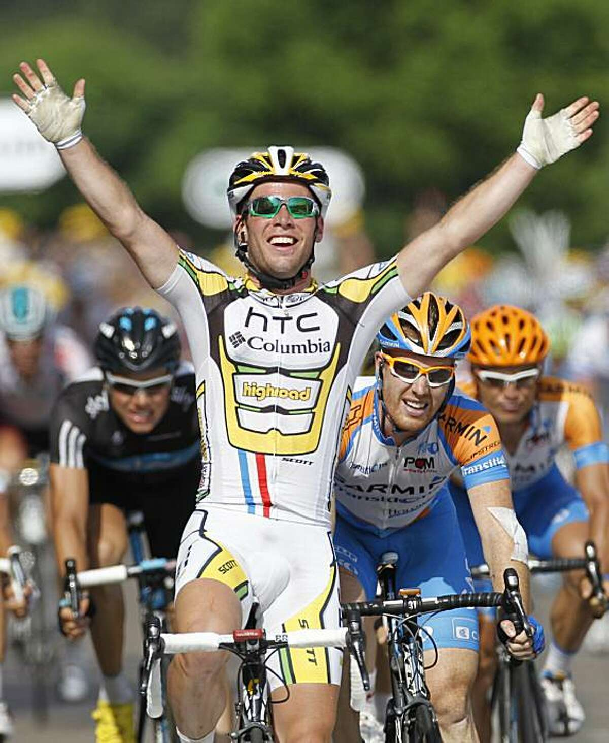 Mark Cavendish of Britain, center, crosses the finish line to win the sixth stage of the Tour de France cycling race over 227.5 kilometers (141.4 miles) with start in Montargis and finish in Gueugnon, France, Friday, July 9, 2010, ahead of Tyler Farrar of the US, right, and Edvald Boassson Hagen of Norway, left.