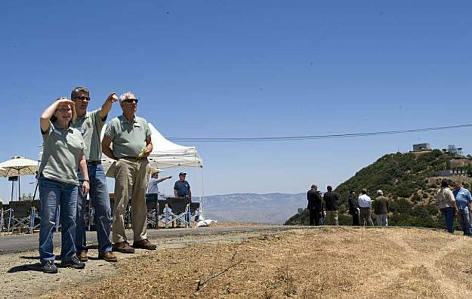 Members of the Midpeninsula Regional Open Space preserve take in the 360 degree view as they look toward the Pacific Ocean at the press briefing on Friday, July 9, 2010, held to announce the allocation of $3.2 million in federal funding to clean up and restore Mt. Umunhum, the former Almaden Air Force station. Photo: Chad Ziemendorf, The Chronicle