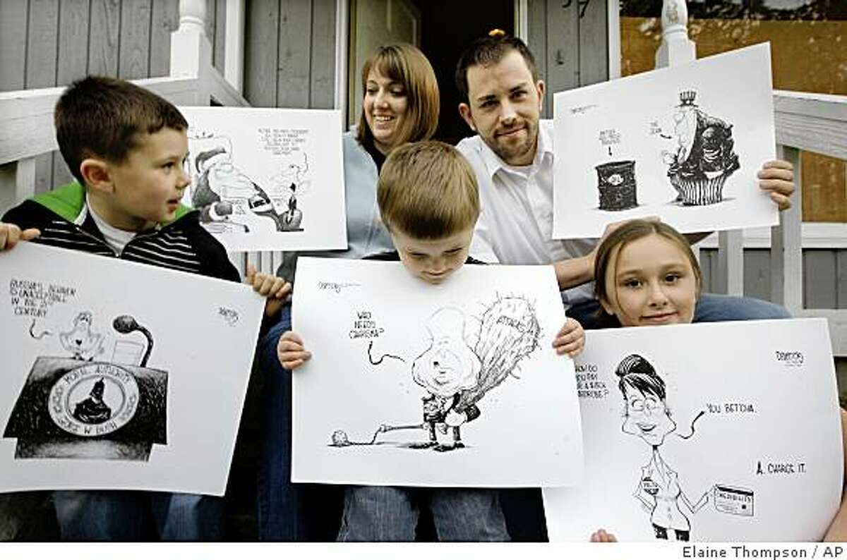 **ADVANCE FOR TUESDAY, DEC. 2** Eric Devericks, top right, recently laid-off from his job as an editorial cartoonist at The Seattle Times, shows off some of his artwork with his wife Brandi and children Sullivan, 5, left, Finnigan, 2, and Amara, 8, Monday, Nov. 24, 2008, in Kenmore, Wash. (AP Photo/Elaine Thompson)