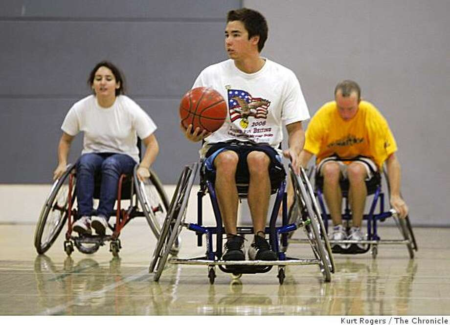 Kevin Nielsen 18 moves the ball down court during the wheelchair basketball class at UC Berkeley on Friday Nov 14,  2008 in Berkeley, Calif. Photo: Kurt Rogers, The Chronicle