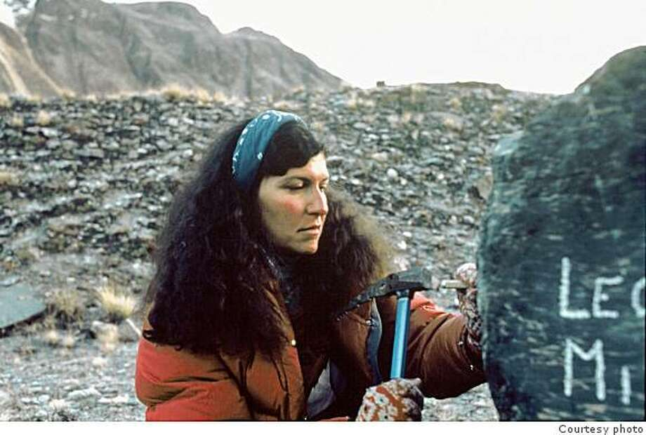 Arlene Blum soberly chisels the names of Vera Watson and Alison Chadwick-Onyszkiewicz into a boulder at base camp, two climbers who fell to their deaths during the otherwise successful campaign to put a women's team on the summit of Annapurna in 1978. Photo: Handout, Courtesy Photo