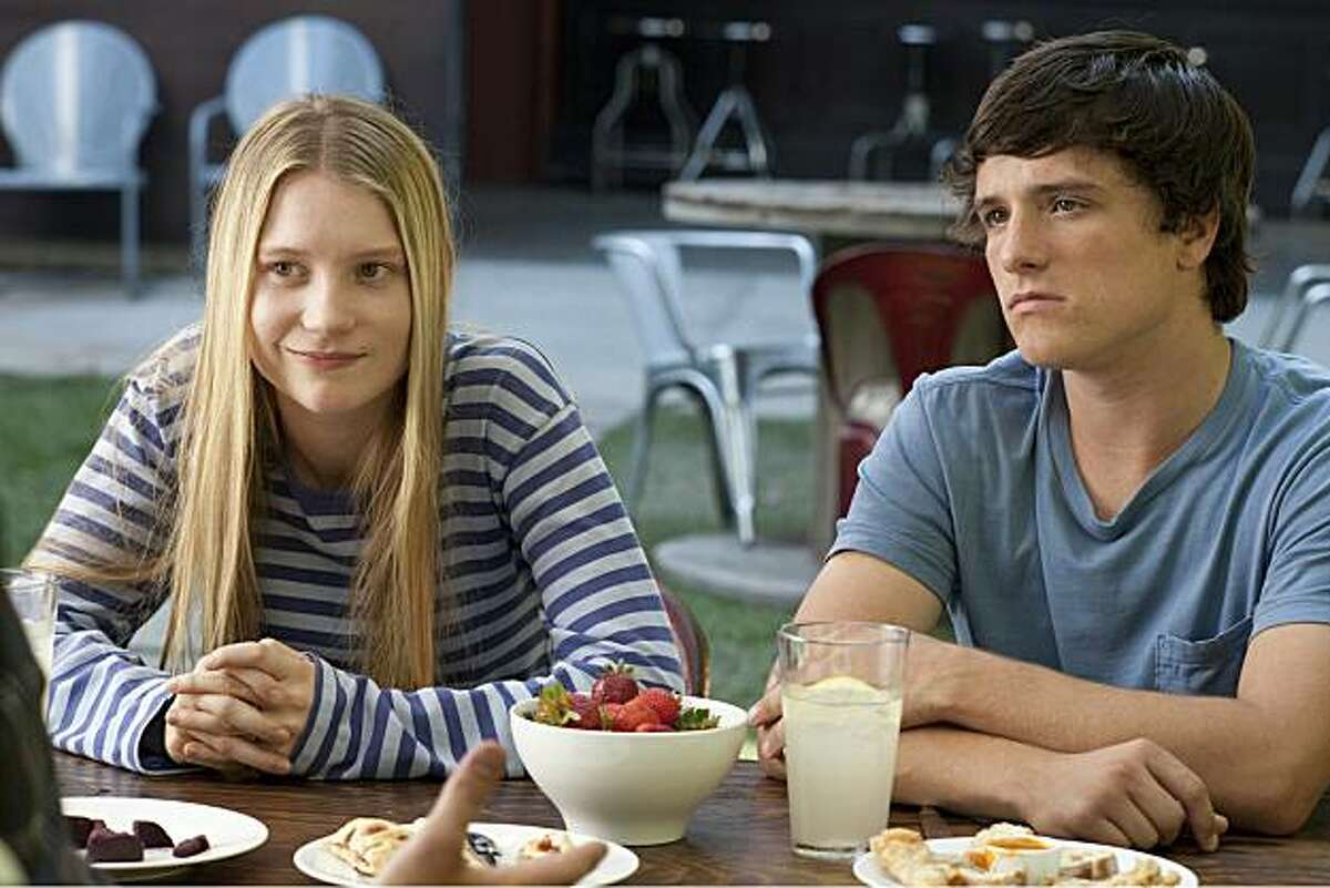 Mia Wasikowska (left) and Josh Hutcherson (right) star as Joni and Laser in Lisa Cholodenko?•s THE KIDS ARE ALL RIGHT, a Focus Features release.