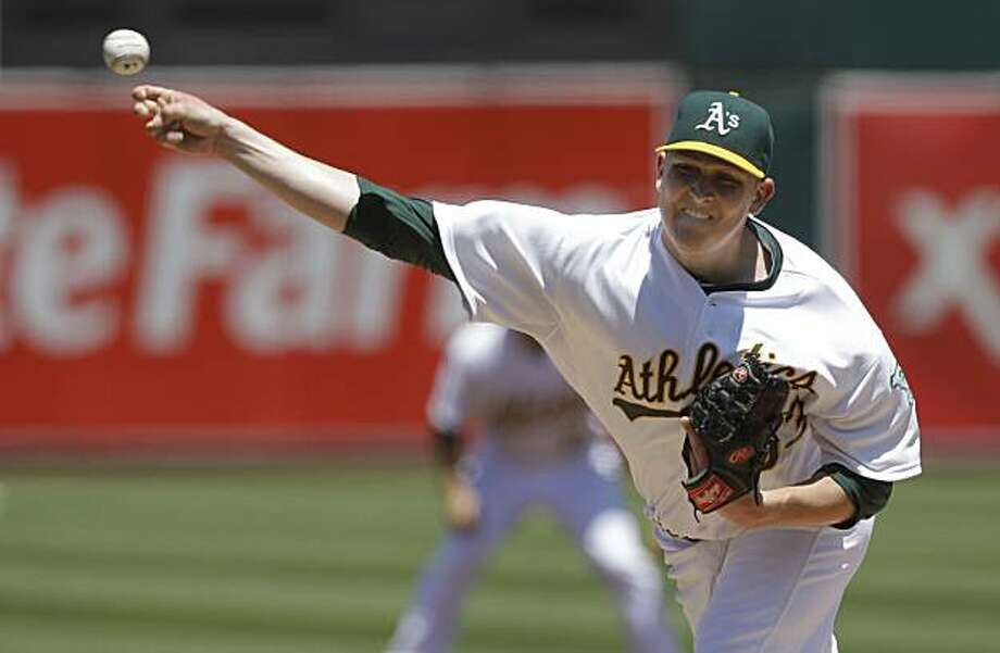Oakland Athletics' Trevor Cahill pitches against the Los Angeles Angels during the first inning of a baseball game in Oakland, Calif., Sunday, July 11, 2010. Photo: Jeff Chiu, AP