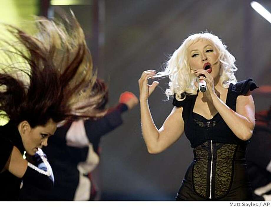 Christina Aguilera performs at the American Music Awards in Los Angeles on Sunday, Nov. 23, 2008. Photo: Matt Sayles, AP