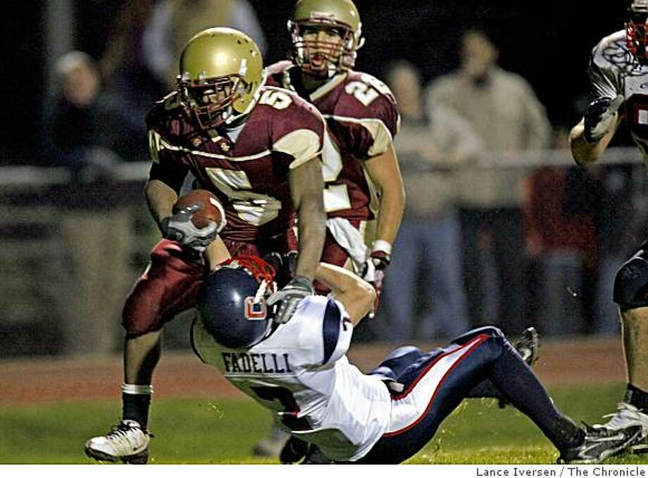 Cardinal Newman's Joe Ferguson runs through Campolindo CB Anthony Fadelli to score a 4th quarter touchdown. Cardinal Newman defeated Campolindo 38-28 in Santa Rosa, Calif., on Friday, Dec. 6, 2008 Photo: Lance Iversen, The Chronicle