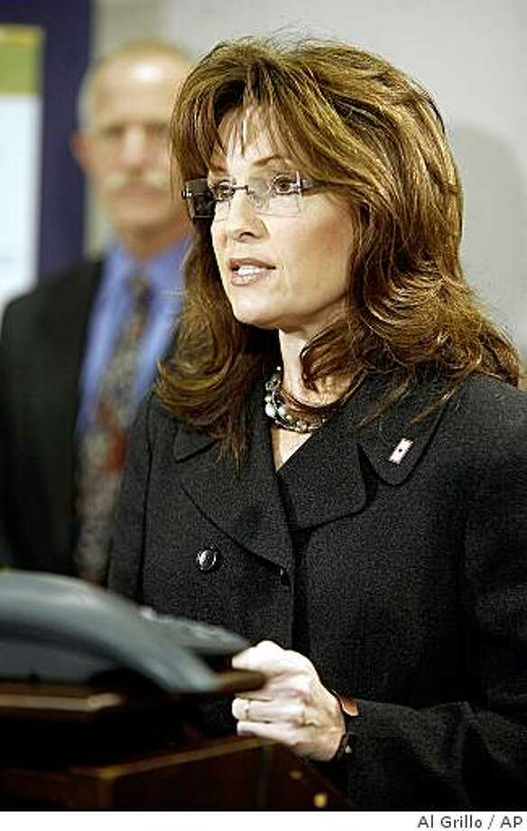 Alaska Governor Sarah Palin talks about the state's health initiatives during a news conference in Anchorage, Alaska on Thursday Dec. 4, 2008 as  Chief Medical Officer Jay Butler listens. Photo: Al Grillo, AP