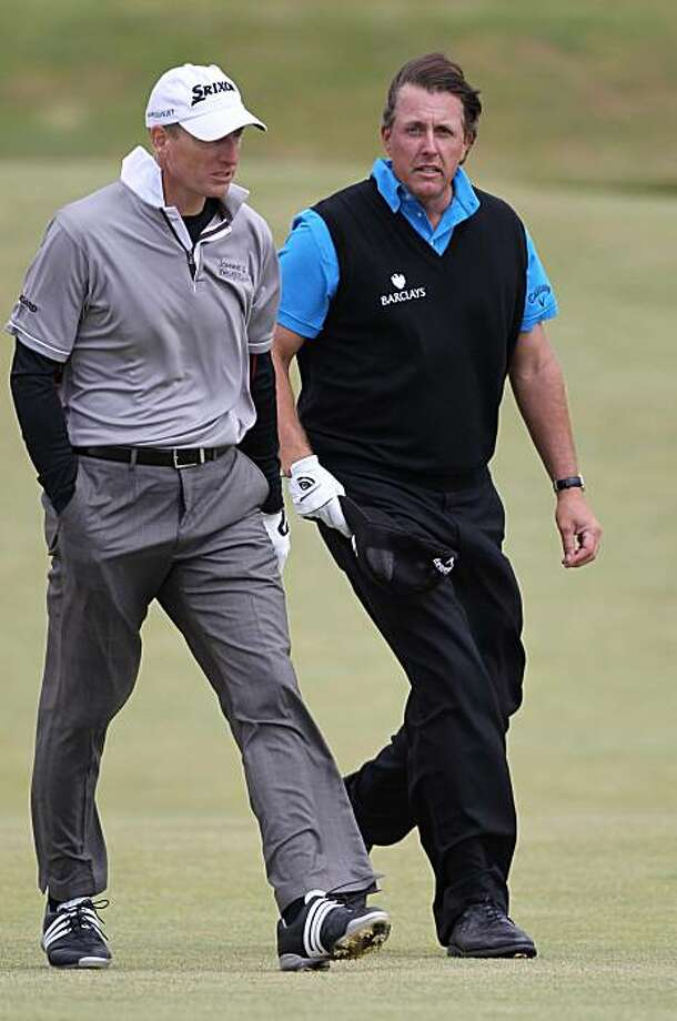 U.S. golfers Phil Mickleson, right, and Jim Furyk walk along the 12th fairway at the Old Course, St Andrews, Scotland, Sunday, July, 11, 2010. Photo: Peter Morrison, AP