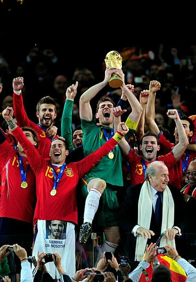 JOHANNESBURG, SOUTH AFRICA - JULY 11:  Iker Casillas of Spain celebrates as he lifts the World Cup with team mates during the 2010 FIFA World Cup South Africa Final match between Netherlands and Spain at Soccer City Stadium on July 11, 2010 in Johannesburg, South Africa. Photo: Jamie McDonald, Getty Images