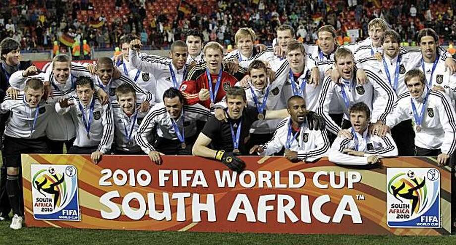 Germany players pose with their bronze  medals at the end of the World Cup third-place soccer match between Germany and Uruguay at Nelson Mandela Bay Stadium in Port Elizabeth, South Africa, Saturday, July 10, 2010. Germany won 3-2. Photo: Gero Breloer, AP