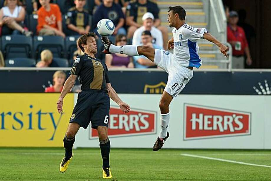 CHESTER, PA - JULY 10: Chris Wondolowski #8 of the San Jose Earthquakes kicks the ball in front of the face of Stefani Miglioranzi #6 of Philadelphia Union at PPL Park on July 10, 2010 in Chester, Pennsylvania. San Jose beat Philadelphia 2 - 1. Photo: Drew Hallowell, Getty Images