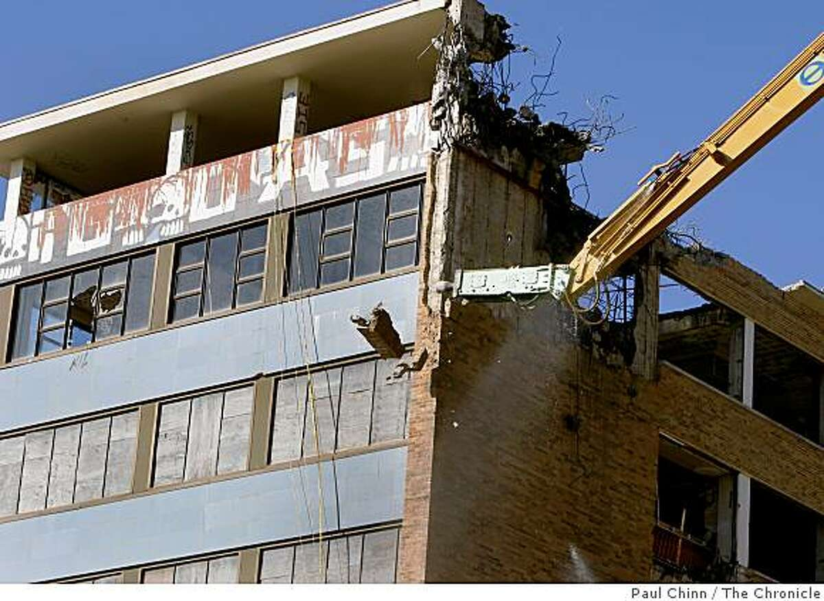 Work crews began demolishing the long-abandoned Public Health Service Hospital at the Presidio in San Francisco, Calif., on Thursday, Dec. 4, 2008.