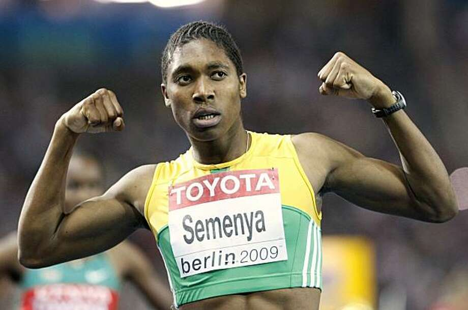 """In this Aug. 19, 2009 file photo, South Africa's Caster Semenya celebrates after winning the gold medal in the final of the Women's 800m at the World Athletics Championships in Berlin.  Semenya has been cleared to return to competitive athletics bythe IAAF with immediate effect. Athletics' world governing body gave Semenya the go-ahead to compete again in a statement Tuesday July 6, 2010, saying """"the IAAF accepts the conclusion of a panel of medical experts that she can compete with immediate effect."""" Photo: Anja Niedringhaus, AP"""