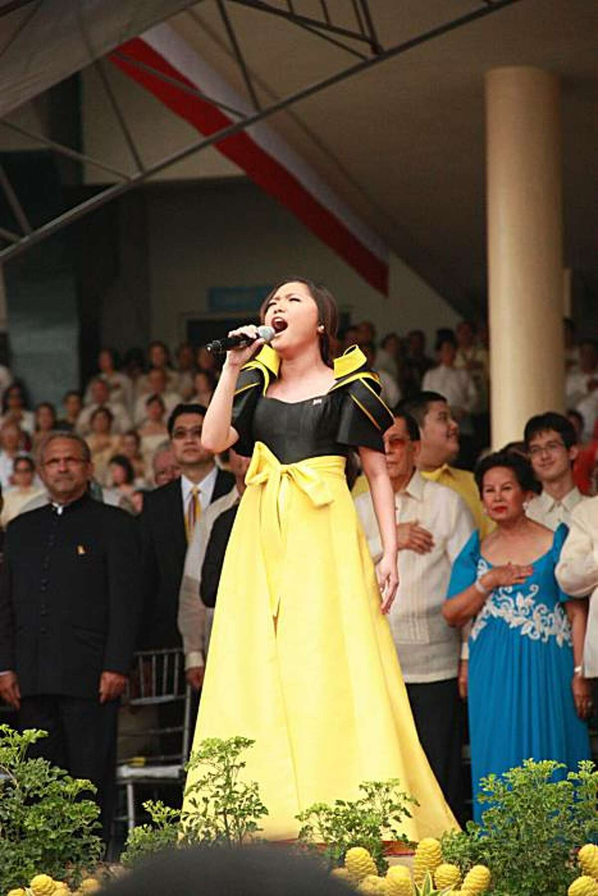 """Charice Pempengco, Filipina teen star and newly appointed cast member of hit TV series """"Glee,"""" singing the Philippines' national anthem at the inauguration of President Benigno Aquino III in Manila on June 30, 2010."""