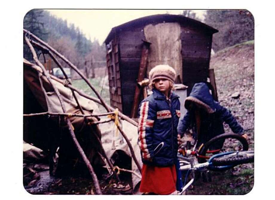 Karuna Greenberg and the fish wagon at the Black Bear Ranch commune c. 1975. Photo: Tom Drury