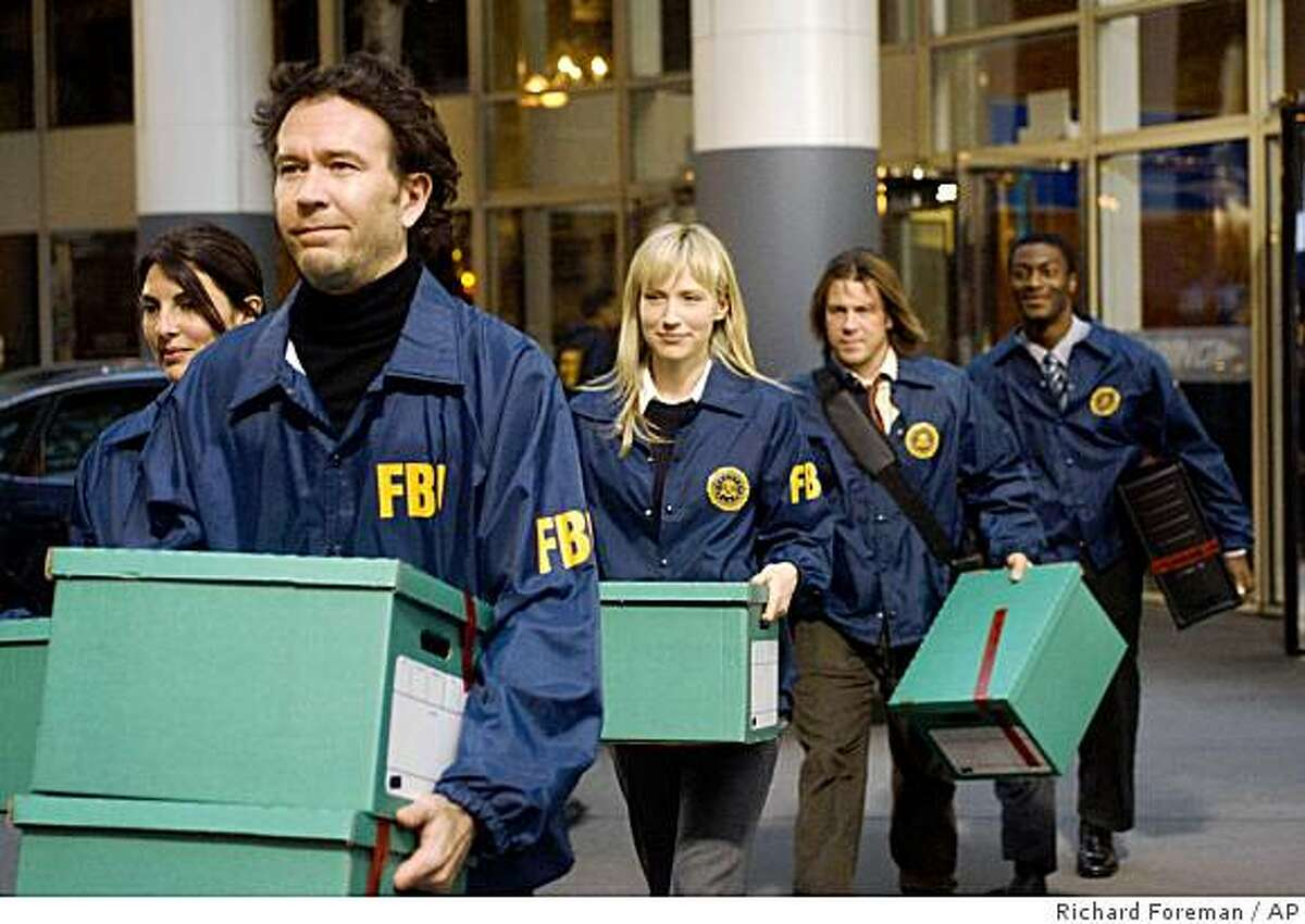 In this image released by TNT, Timothy Hutton, foreground left, is shown in a scene with co-stars, from left, Gina Bellman, Beth Riesgraf, Christian Kane and Aldis Hodge, from the new TNT drama,