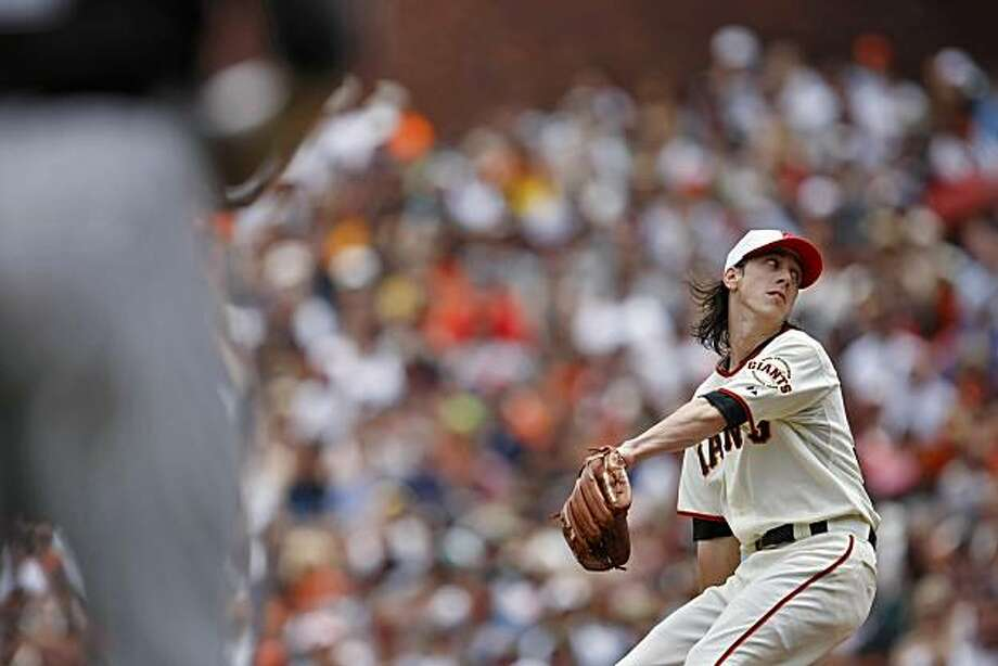 San Francisco Giants pitcher Tim Lincecum pitches with Colorado Rockies runners on first and third, Monday May 31, 2010, in San Francisco, Calif. The Giants lost to the Rockies 4-0, in the first game of the series. Photo: Lacy Atkins, The Chronicle