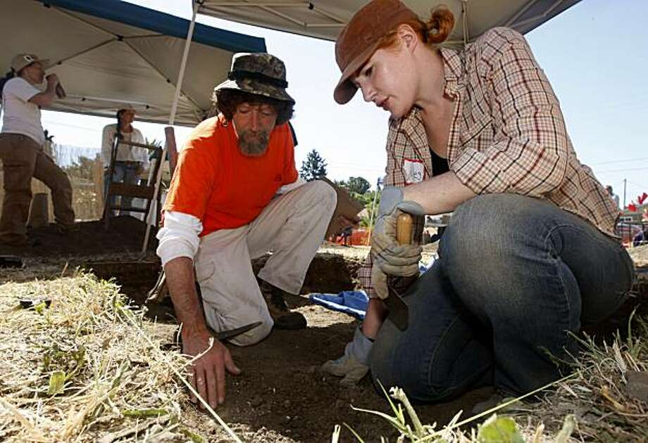 Phil Loyd and Jules Evans-White search for 19th century artifacts at an archeological dig in Sonoma, Calif., on Thursday, July 8, 2010. The weeklong excavation was organized by George McKale, the town historian and archeologist, to mark Sonoma's 175th anniversary. Photo: Paul Chinn, The Chronicle