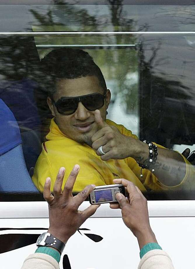 Kevin Prince Boateng gives a thumbs up to a fan taking a picture, as the Ghana national soccer team greets supporters in Soweto Township in Johannesburg, South Africa Sunday, July 4, 2010.  The Ghanaian team became the third African team ever to reach theWorld Cup quarterfinal round, where they were defeated by Uruguay. Photo: Rebecca Blackwell, AP