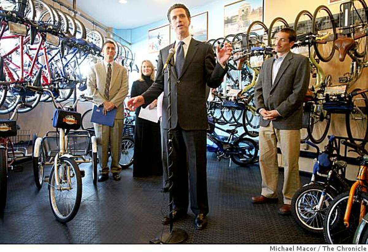 """Mayor Gavin Newsom, center, holds a news conference where he announced a bicycle sharing program,""""Bike and Shop"""", the first of it's kind program in the country, was made in San Francisco, Calif., on Thursday Dec.. 4, 2008. Shop full of bicycles at the """"Bike and Roll"""" rental shop in North Beach."""