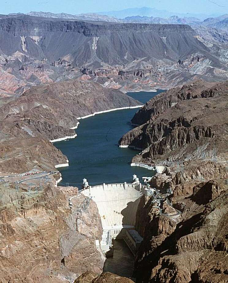 The Colorado River flows to the Hoover Dam east of Boulder City, Nev., June 11, 2001. U.S. Interior Secretary Gale Norton is scheduled to sign a pact Thursday, Oct. 16, 2003, that ends years of bickering over the Colorado River and fulfills a promise that California made 70 years ago to limit its use of the river it shares with six other Western states. Photo: Jim Laurie, AP