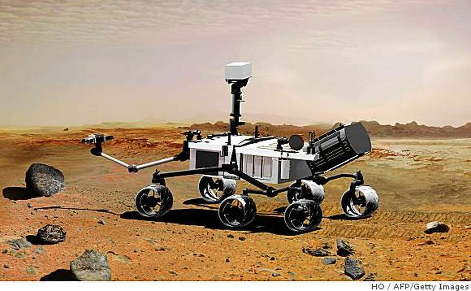 "This NASA handout photo shows the Mars Science Laboratory, a mobile robot for investigating Mars' past or present ability to sustain microbial life. This picture is an artist's concept portraying what the advanced rover would look like in Martian terrain, from a side aft angle. The arm extending from the front of the rover is designed both to position some of the rover's instruments onto selected rocks or soil targets and also to collect samples for analysis by other instruments.Technical glitches have forced NASA to delay the launch of a landmark mission to Mars, which was due to lift off in the autumn of next year, officials said on December 4, 2008. ""We will not be ready to launch Mars Science Lab by the hoped-for date next year,"" NASA administrator Michael Griffin told a news conference.  ""Because of a number of factors that need to be addressed, we are slipping the launch to 2011,"" he said. The delay from the scheduled launch will add around 400 million dollars to the already over-budget Mars Science Lab project, which aims to assess whether microbial life ever existed on the red planet and still exists now. With the delay factored in, the life-cycle cost of Mars Science Lab will rise to some 2.3 billion dollars, NASA estimated. AFP PHOTO/NASA/JPL-CALTECH/HANDOUT/RESTRICTED TO EDITORIAL USE =GETTY OUT= (Photo credit should read HO/AFP/Getty Images) Photo: HO, AFP/Getty Images"