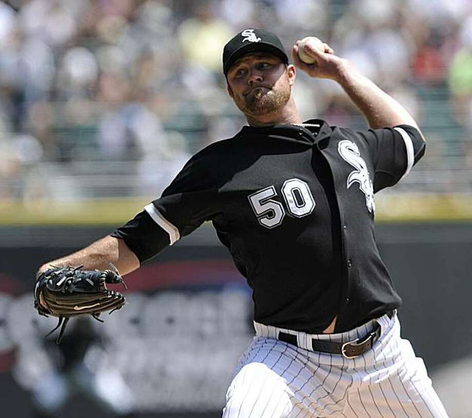Chicago White Sox's John Danks pitches against the Los Angeles Angels during the first inning of a baseball game Thursday, July 8, 2010, in Chicago. Photo: Jim Prisching, AP