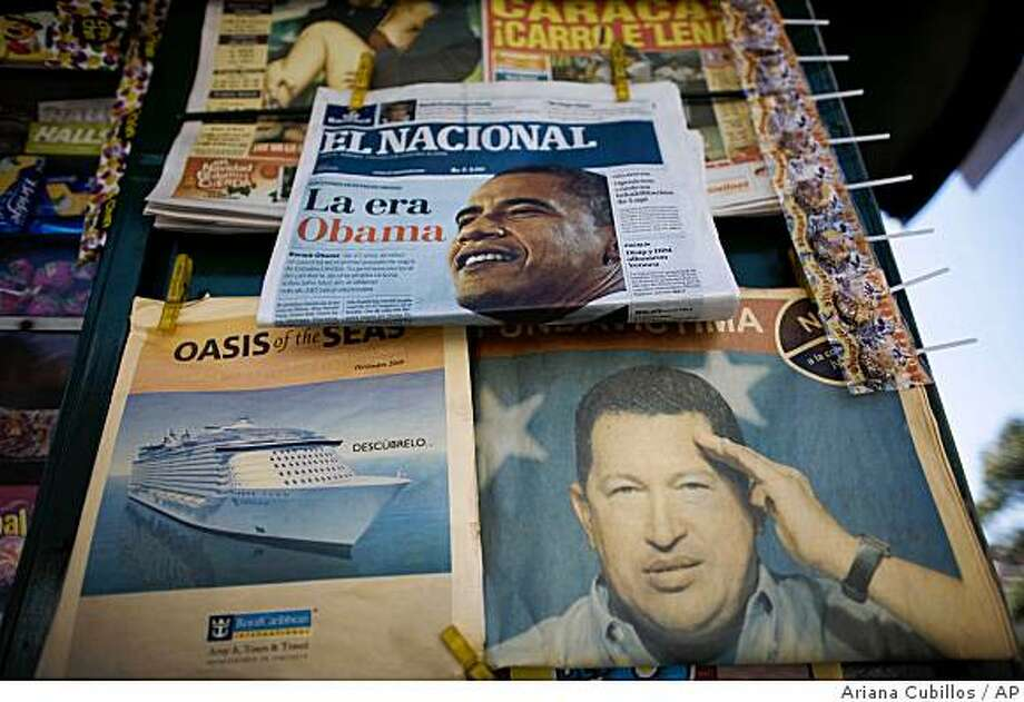 A front page of Venezuelan newspaper  'El Nacional', with a headline in Spanish that reads ' the Obama era' and a photo of Sen. Barack Obama is seen next to a picture of Venezuela's President Hugo Chavez, bottom,  at a news stand in Caracas, Wednesday, Nov. 5, 2008. After Obama's victory the Venezuelan foreign minister issued a statement saying that President Chavez will be ready to 'establish new relations' with the upcoming U.S administration of President-elect Obama.(AP Photo/Ariana Cubillos) Photo: Ariana Cubillos, AP