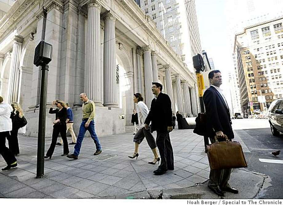 Pedestrians pass One Sansome St. in San Francisco on Monday, March 17, 2008. The building was pulled from the sales block this year because of the lack of accessible credit. The building was also heavily occupied by the flailing Citigroup. Photo: Noah Berger, Special To The Chronicle