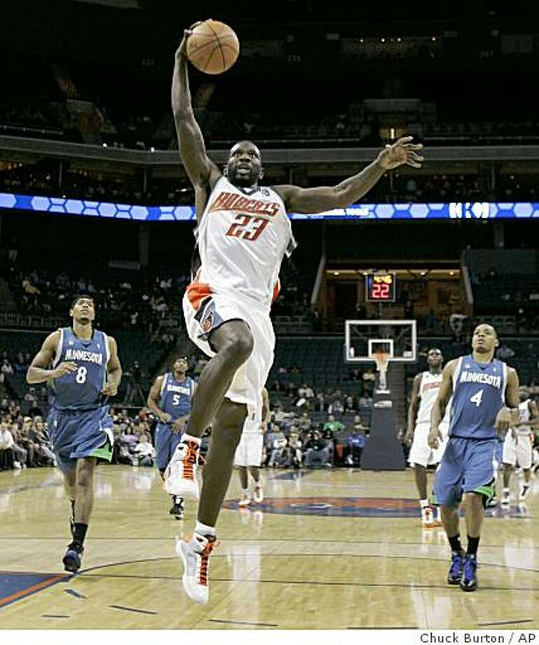 Charlotte Bobcats guard Jason Richardson (23) drives past Minnesota Timberwolves forward Ryan Gomes (8) and guard Randy Foye (4) for a dunk during the second half of the Bobcats' 100-90 win in an NBA basketball game in Charlotte, N.C., Monday, Dec. 1, 2008. (AP Photo/Chuck Burton) Photo: Chuck Burton, AP