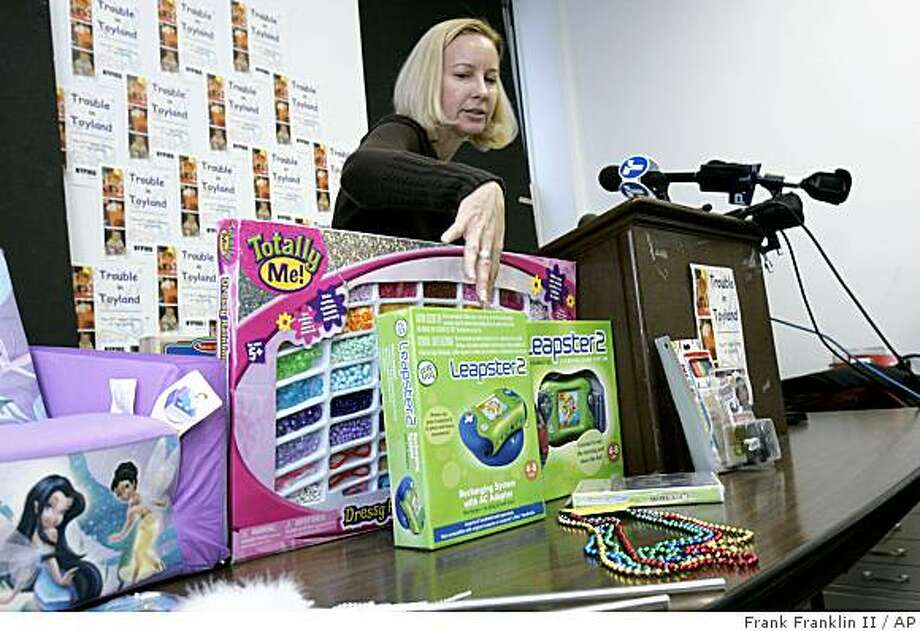 Tracy Shelton, of the New York Public Interest Research Group, points to a toy called 'Leapster 2' which contained toxic levels of arsenic while speaking during a news conference to bring attention to toys that are dangerous for children Wednesday, Dec. 3, 2008  in New York. According to data from the Consumer Product Safety Commission,  toy related injuries affected 80,000 children under the age of five in 2007. (AP Photo/Frank Franklin II) Photo: Frank Franklin II, AP