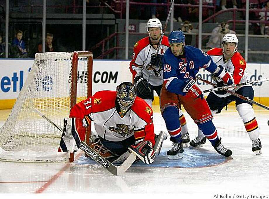 NEW YORK - NOVEMBER 30:  Craig Anderson #31 of the Florida Panthers makes a save against Scott Gomez #19 of The New York Rangers on November 30, 2008 at Madison Square Garden in New York City.  (Photo by Al Bello/Getty Images) Photo: Al Bello, Getty Images