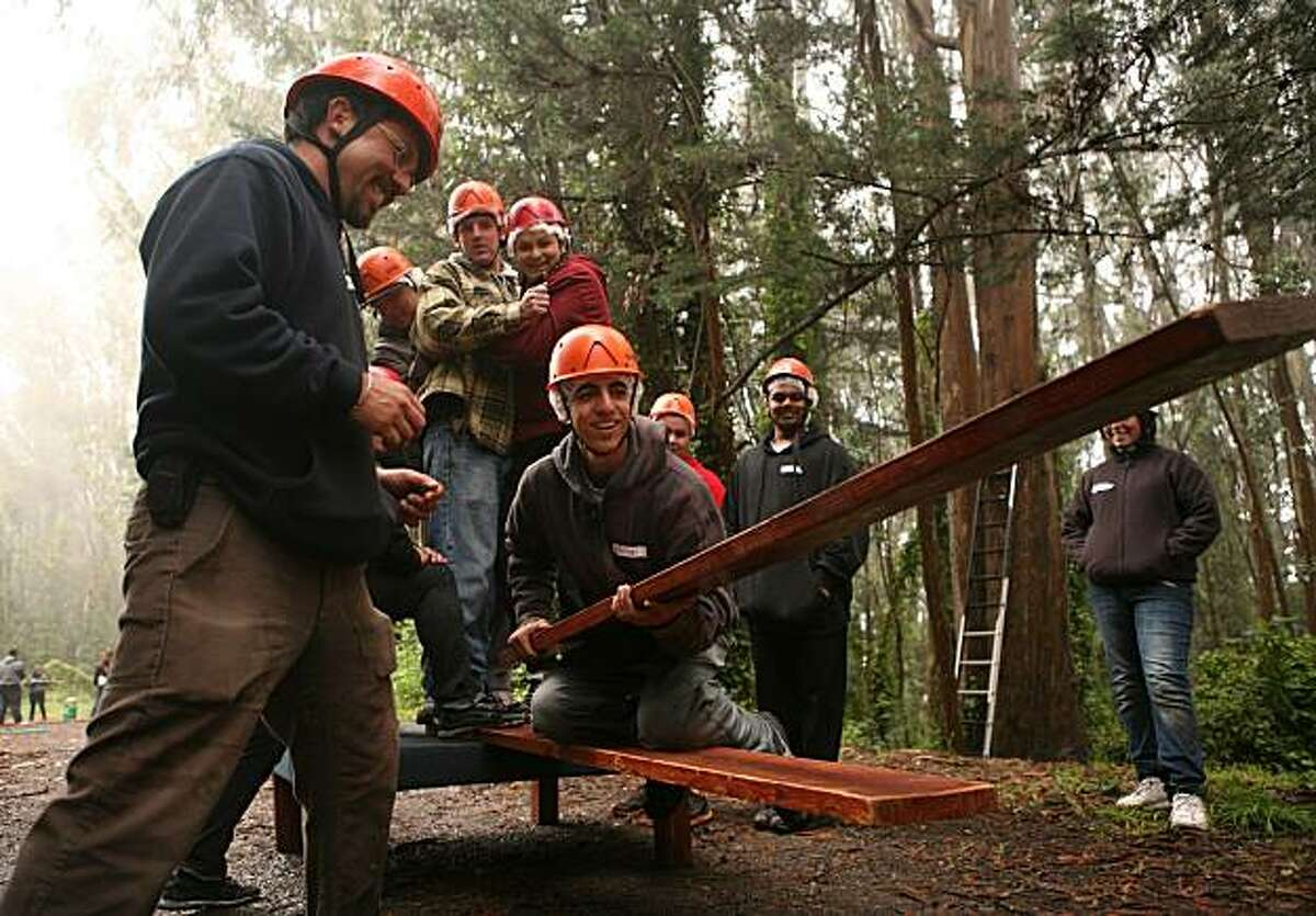 Milton Casalongue, an 18 year old student at Mission High School and participant of the Law Enforcement Cadet Program, participates in a team-bonding activity in the San Bruno Mountain State and County Park in Brisbane, Calif. on Friday June 25, 2010 with the assistance of instructor Edward Lopez (left). The Law Cadet Program is sponsored by the Police Activities League, a non-profit organization which builds leadership skills and finds internships for all of the graduates of its programs.