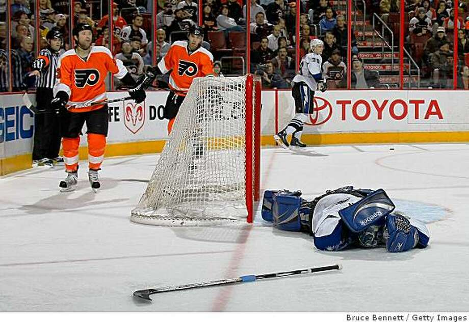 PHILADELPHIA - DECEMBER 02:  Goaltender Mike Smith #41 of the Tampa Bay Lightning lies on the ice after being hit in his game against the Philadelphia Flyers on December 2, 2008 at the Wachovia Center in Philadelphia, Pennsylvania. (Photo by Bruce Bennett/Getty Images) Photo: Bruce Bennett, Getty Images