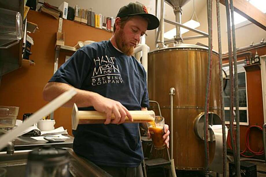 Kirk Hillyard, Brew Master, tests recently brewed beer at the Half Moon Bay Brewing Company in Half Moon Bay, Calif on Thursday July 1, 2010. The Half Moon Bay Brewing Company, a local restaurant and brewery known for its charity work and delicious beer, is celebrating its tenth anniversary on July 1, 2010. Photo: Jasna Hodzic, The Chronicle