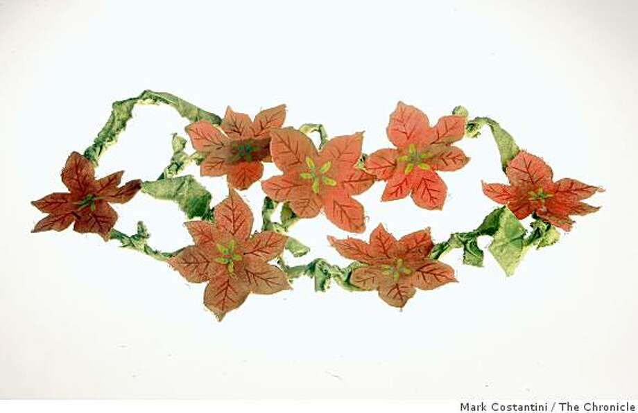Cloth poinsettia garland from Green Party Goods. Photo: Mark Costantini, The Chronicle