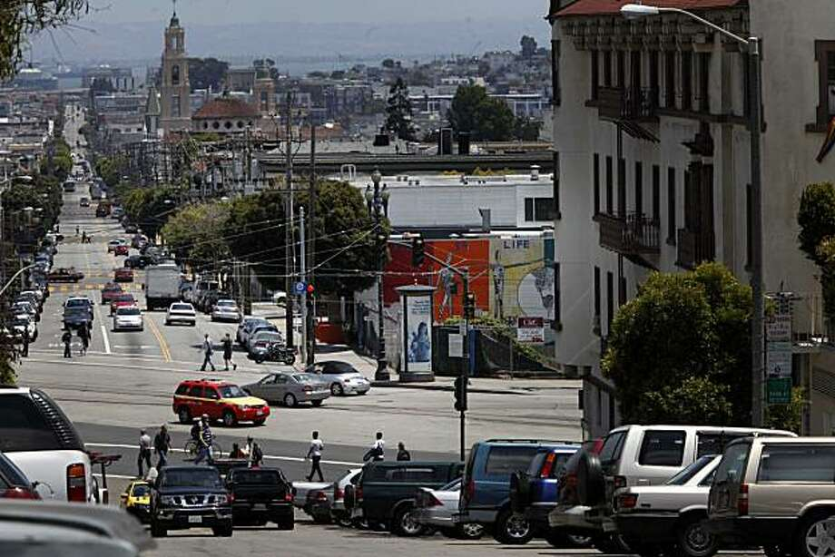 """An empty lot, the topic of much debate in after city planners """"orphaned"""" the block of Market Street between Noe and Castro when they created the Octavia development district, sits empty as people and traffic move by on Wednesday July, 7, 2010 in San Francisco, Calif. Photo: Mike Kepka, The Chronicle"""